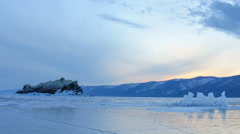 Sunset on the frozen Lake Baikal, Elenka island. Irkutsk region, Russia. Full HD Stock Footage