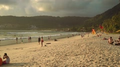 Patong Phuket beach with dark clouds and yellow sunlight - before the rain Stock Footage