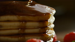 Static shot of maple syrup dripping down stacked pancakes, in slow motion Stock Footage