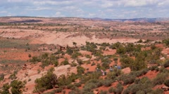 People hiking through a hot desert in Utah Stock Footage