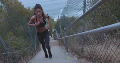 Female athlete climbing up the steps - stock footage