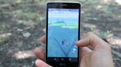 Pokemon Go game in a hand Stock Footage