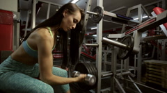 Sportive young woman doing exercise with barbell. - stock footage