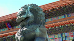 Closeup Bronze lion in front of the Hall of Supreme Harmony Stock Footage
