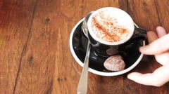 Hot chocolate drink served with soft small chocolate and cocoa powder Stock Footage