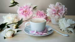 Fresh cappuccino in the white cup, still life with peonies. HD cinemagraph - Stock Footage
