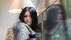 Beautiful girl sitting on a background of the rainy window. HD cinemagraph - Stock Footage