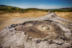 Active muddy volcano - stock photo