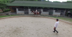 Equestrian traning  women riding horse Stock Footage