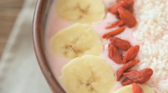 Healthy smoothie breakfast bowl topped with goji and berries Stock Footage