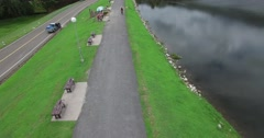 Cyclist towards oncoming fixed aerial position high angle Stock Footage