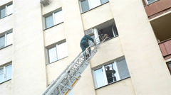 Man rescue person from fire with stairs Stock Footage