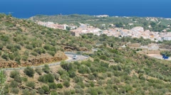 The road in the mountains with moving cars. Near the Spanish town of Cadaques Stock Footage