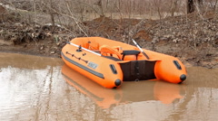Rescue boat in the water during a flood Stock Footage