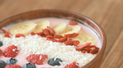 Delicious smoothie in the bowl with berries and goji Stock Footage