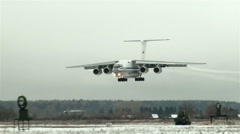 The plane comes in to land in rainy and cloudy weather Stock Footage