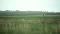 Small private planes on green field Stock Footage
