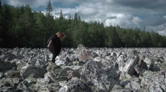 Girl goes on the rocks Stock Footage