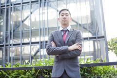 Ambitious Asian Business Person Standing - stock photo