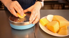 closeup shot grating cheese with metall grater - stock footage