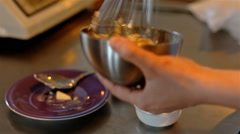 Medium shot mixing products in bowl with corolla Stock Footage