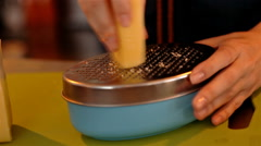 Closeup shot grating cheese with metall grater Stock Footage