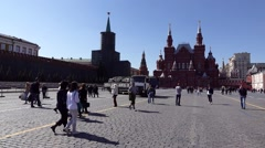 Loaded truck drive on crowded Red Square pass by Kremlin and Lenin's Mausoleum Stock Footage