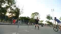 Rollerskater does various tricks in skate park Stock Footage