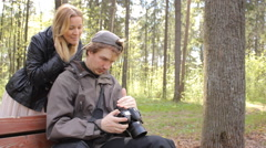 Photographer and photomodel look the result of photo shooting Stock Footage
