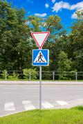 Give way and cross road sign - stock photo