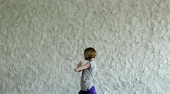 The young blonde girl practicing yoga in the hall. Asana on the balance. HD Stock Footage