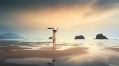 Young woman walking on Pacific Beach and spontaneously dancing for joy Stock Footage