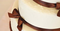 Wedding cake with brown bows Stock Footage