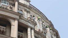 Climber Workers renovating the facade of an old building in the center of Moscow - stock footage