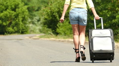 Slow motion. Hot summer and  silhouette of sexy girl with  suitcase on  road. Stock Footage
