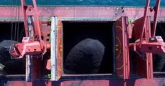 Process of coal loading into bulk cargo ship by big cargo cranes. Nakhodka bay. Stock Footage