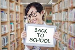 Student with tablet and text of Back to School Stock Photos