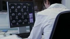 Doctor Working with X-rays on the computer Stock Footage