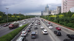 Traffic and cityscape in Urumqi Stock Footage