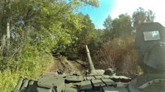 Battle tank riding and firing POV, POVD Stock Footage