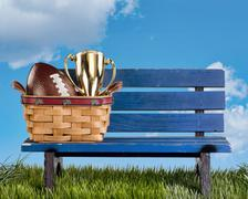 Park bench football and awards. Stock Photos