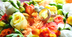 colored bouquet close up of wedding rings - stock footage