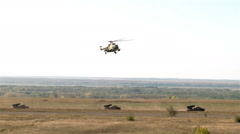 Extra Wind shot Military helicopter landing on battlefield Stock Footage