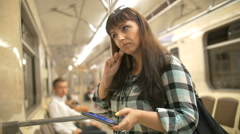 Woman inside underground listening to music with phone, slow motion Stock Footage