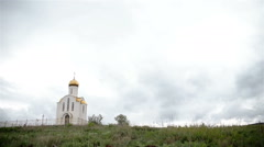 Christian white church in cloudy weather summer - stock footage