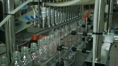 Production of plastic bottles of mineral water lemonade. spilling water bottles Stock Footage