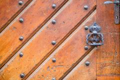 Closeup of brass handle of allwood door - stock photo