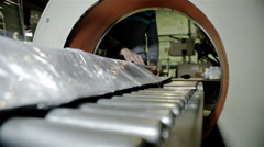 Worker packs in polyethylene some production - stock footage