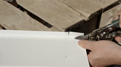 Worker on a construction site cut stainless steel sheet shears of metal cutting Stock Footage