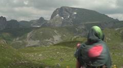 Focus on Girl Enjoying High Mountain Peaks View 4K Stock Footage